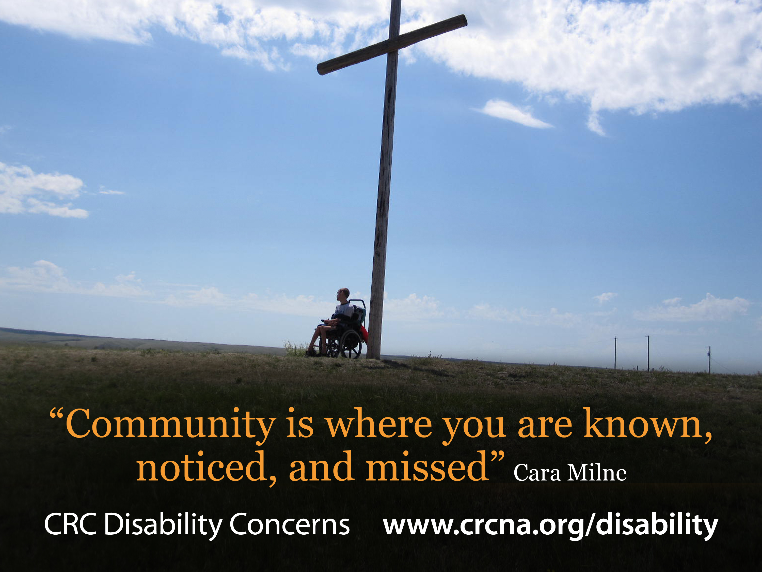 Man in wheelchair at foot of cross