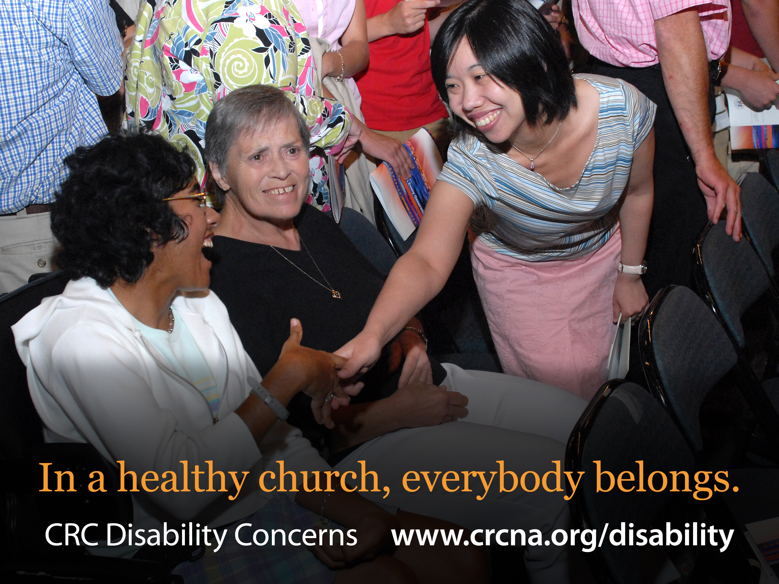 worshipers, including one who uses a wheelchair, greet one another