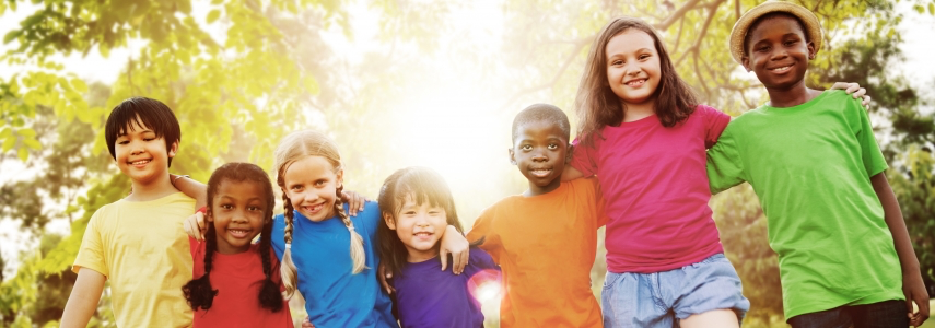 diverse children link arms and smile