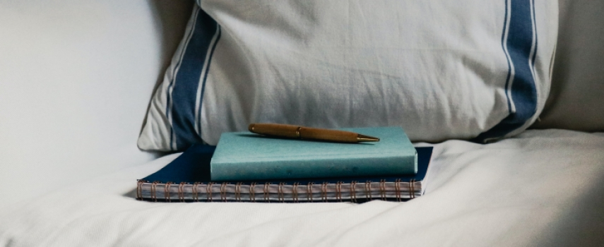 image of journal on pillow