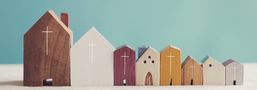 wood building blocks in the shape of churches are lined up next to each other with a wooden house block in the middle