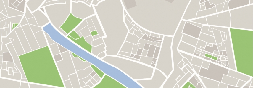 Image content: a digital illustration of a map with white streets on a gray background, with green sections and a body of water