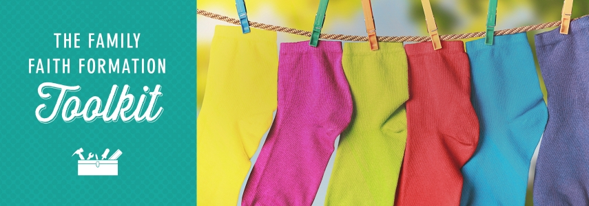"""next to a picture of colorful kids' socks on a clothesline read the words """"Family Faith Formation Toolkit"""""""